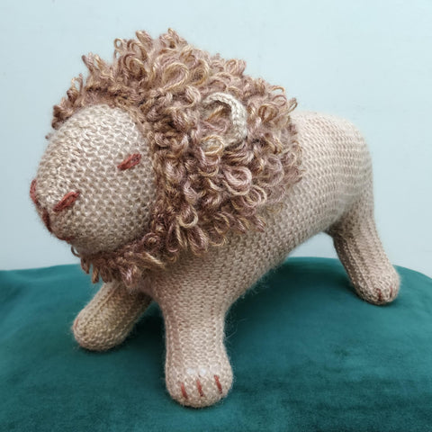 Hand knitted lion