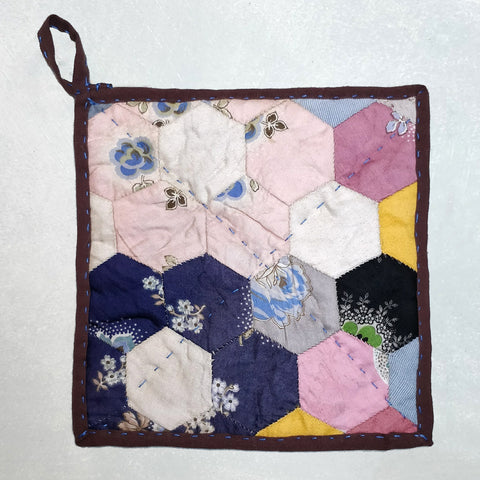 Antique patchwork pot holder