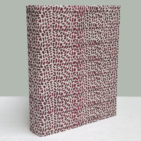Dark red cracked pavement ringbinder