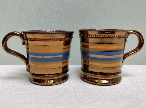 Pair of copper lustre cans c1860