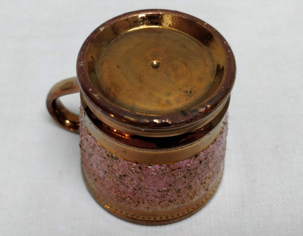 Small copper lustre mug
