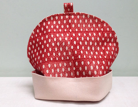 Red inverse seed felt tea cosy