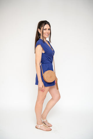 Woman in short romper with purse