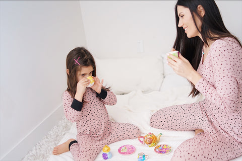 Lav and Kush Rompers mom and daughter drinking tea wearing loungewear on the bed