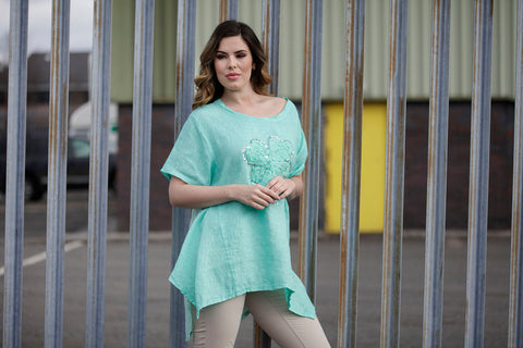 aqua blue linen tunic top with a sequin motif