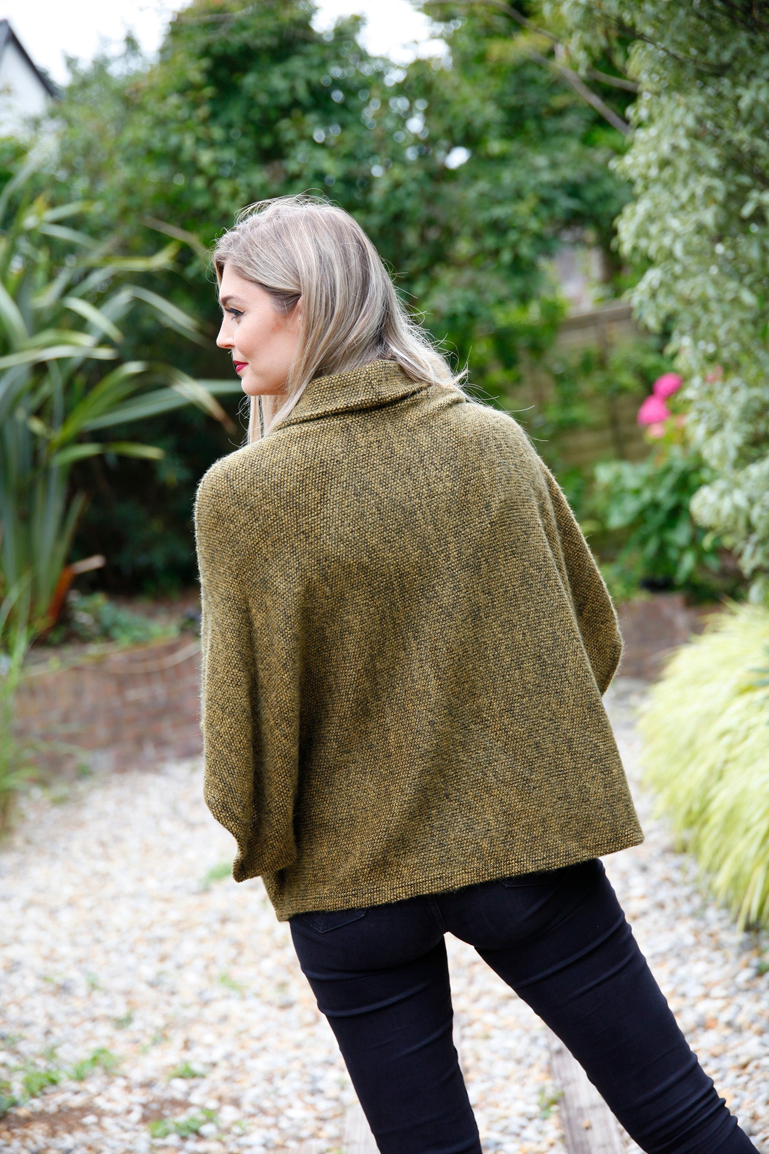 back view of mustard poncho top