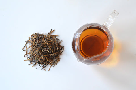 Golden Black Needle tea piled and steeped