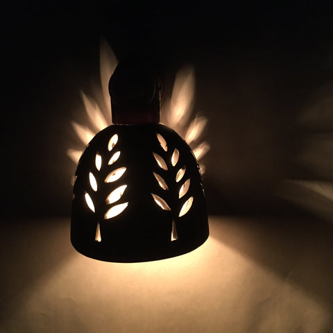 round nightlight with white outlined leaf design