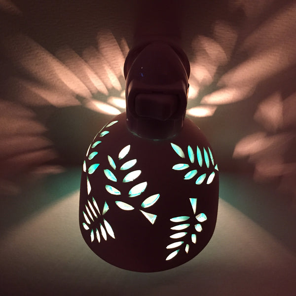"round night light ""curving leaves""  brown/beige with aqua interior"
