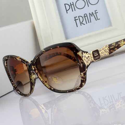 Oversized Amber and Gold Fleck Marbled Frame Sunglasses with Temple Bling