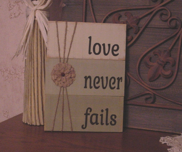 Love Never Fails Distressed Wooden Sign - 113