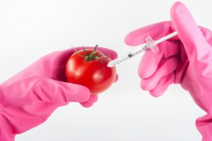 shooting syringe into tomato
