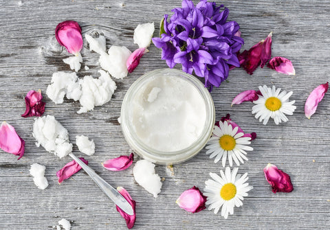 jar of coconut oil and flowers