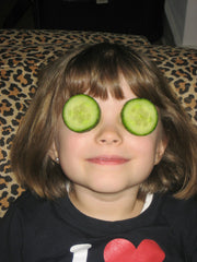 cucumber slices over girls eyes