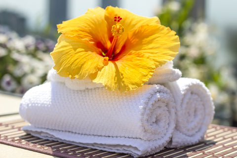 hibiscus flower on spa towels