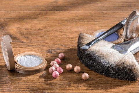 makeup brush and compact