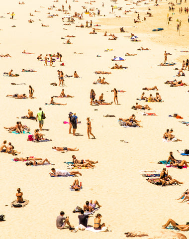 crowds tanning on beach