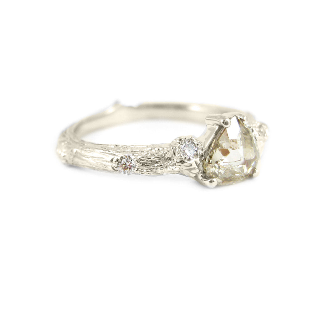 Small Twig ring in 18k white gold with a rose-cut diamond and diamonds.