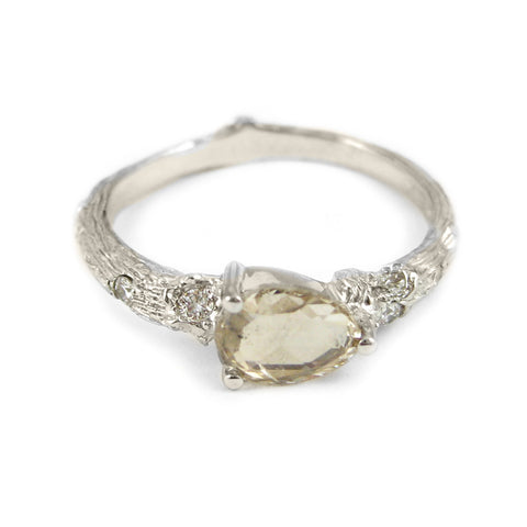 Small Twig ring in 18k white gold with a rose-cut diamond anddiamonds.