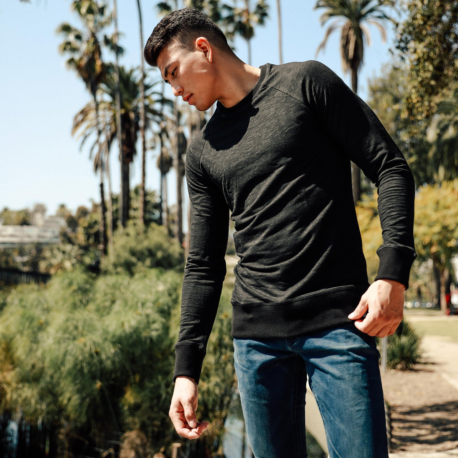 River Raglan Crewneck Sweatshirt in Black - Mitchell Evan