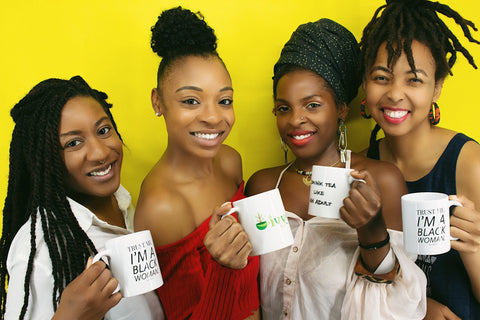 Image of four Black women holding mugs and smiling