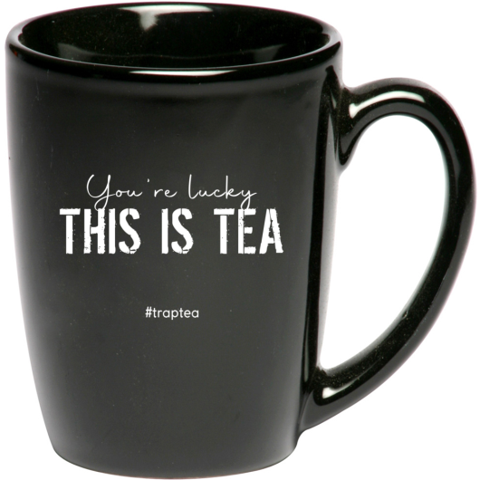 "Black ""You're lucky THIS IS TEA #traptea"" mug against a white background"
