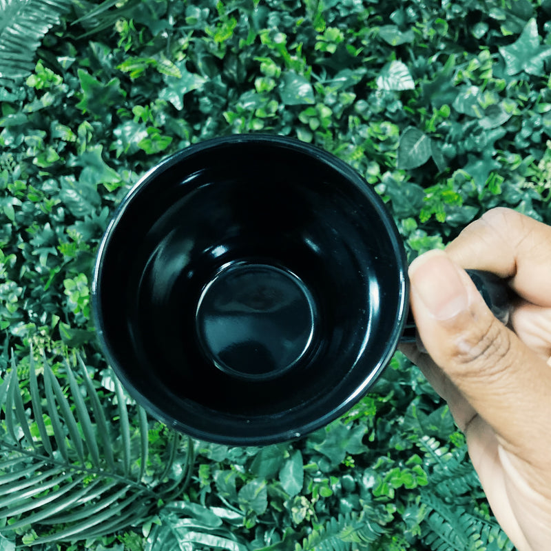 "Interior of black ""You're lucky THIS IS TEA #traptea""mug"
