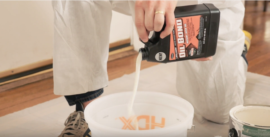 Professional Painter Mixes Oil Bond Into Latex Paint