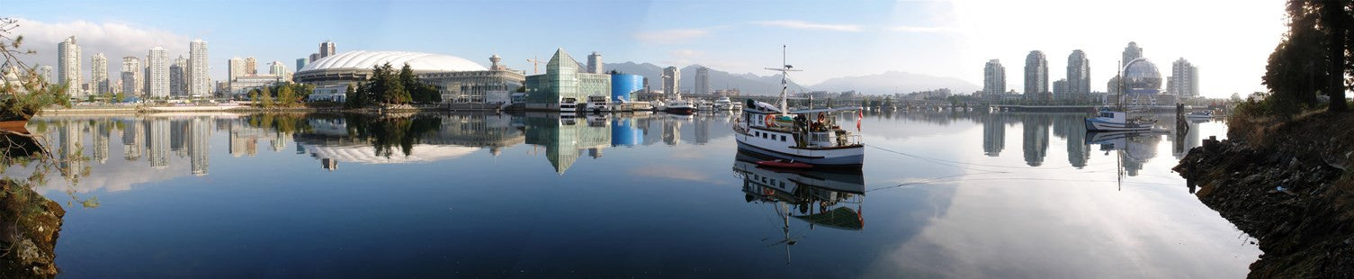 Water view of False Creek in Vancouver with sky and mountains in the back