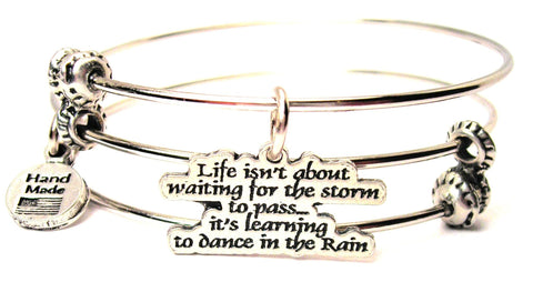 Life Isn't About Waiting For The Storm To Pass Its Learning To Dance In The Rain Triple Style Expandable Bangle Bracelet
