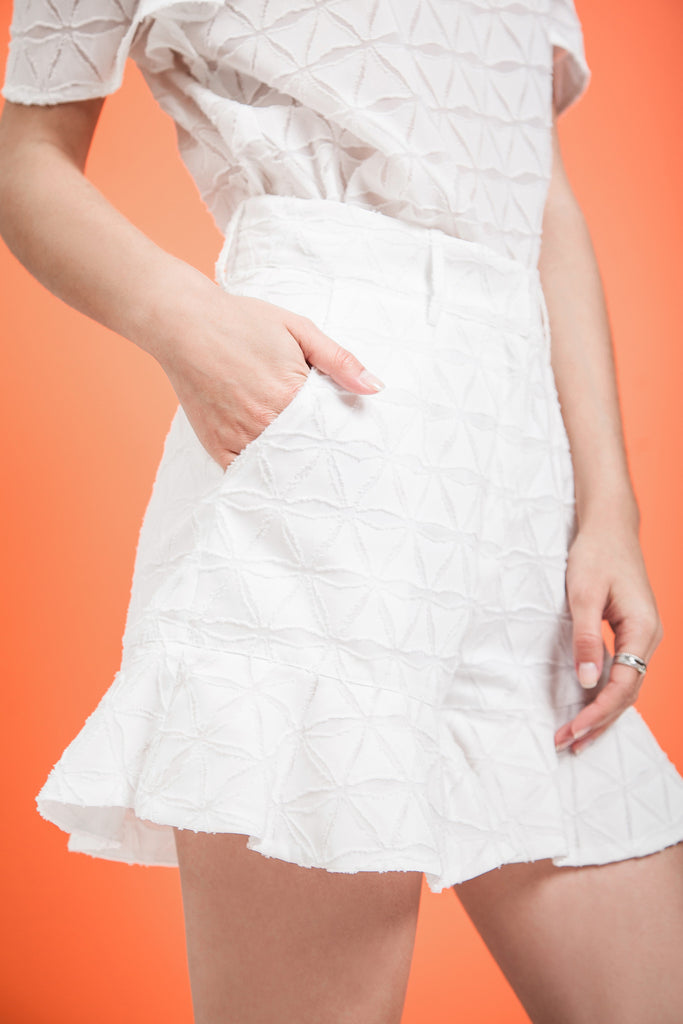 FLARED RUFFLE HEM SHORTS