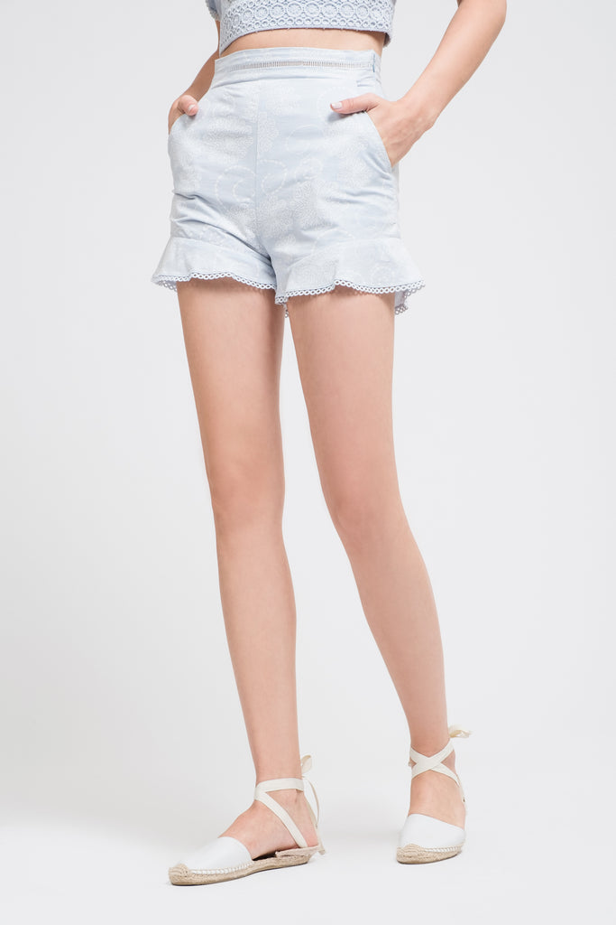 PRINTED SHORTS WITH RUFFLED HEM
