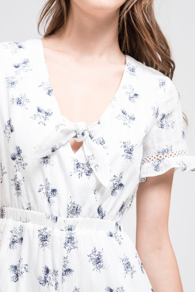SHORT SLEEVE ROMPER WITH RUFFLED HEM