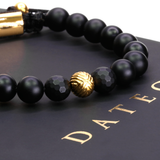 Single EXXE Sphere Yellow Gold & Onyx Faceted