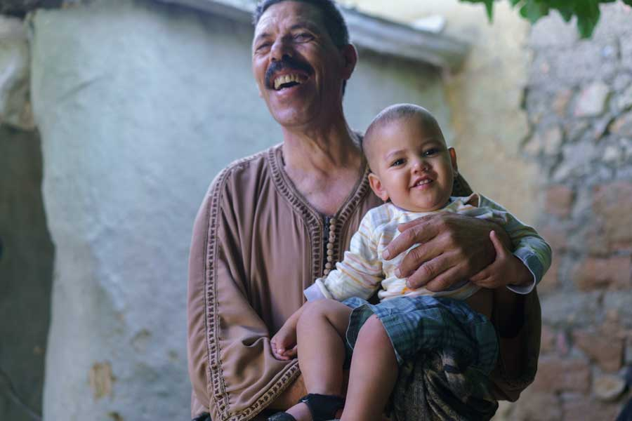 Portrait Of Father and Child In Moroccan Village | Stories + Objects Travel Images
