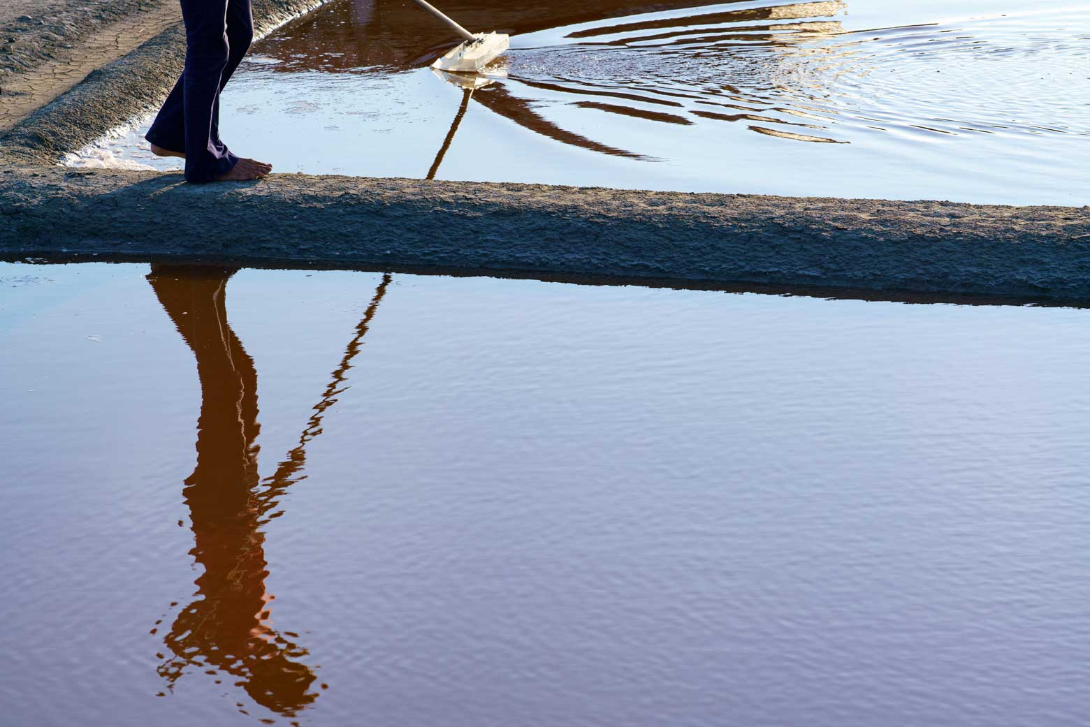 Salt Harvesting Water Reflection In Il De Re, France | Stories + Objects Luxury Travel Magazine