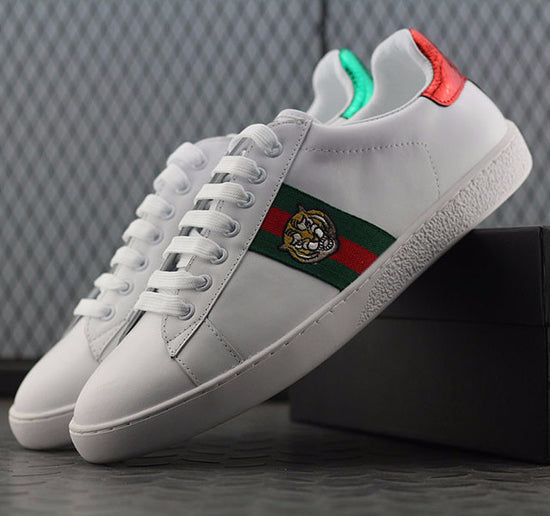 28bad280eada Gucci Ace Tiger Embroidered Low-Top Sneaker