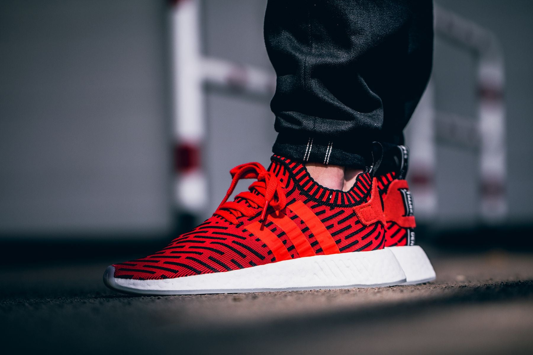 e092b4434f73d adidas nmd r2 primeknit white core red on feet
