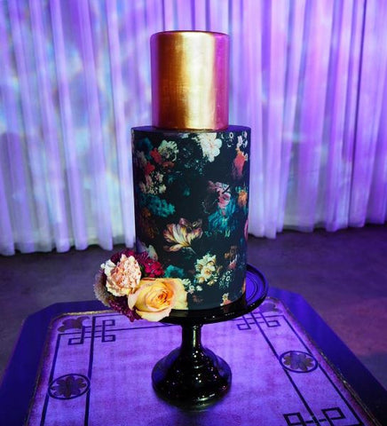 Black floral wrap Alice Broadway cake design