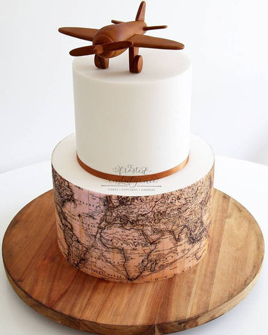 Frosted Indulgence Map Plane cake
