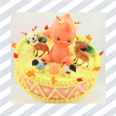 Cake with plastic doll and decorations