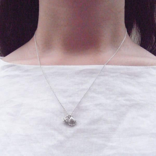Shell and Tiny Star Necklace Silver on Model