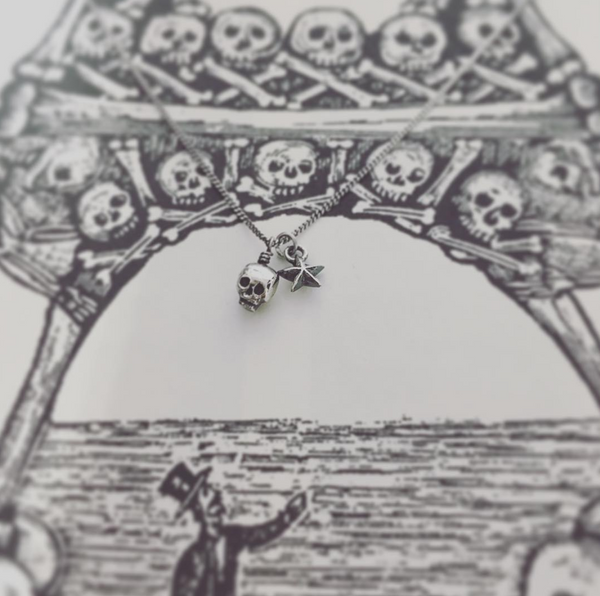 Baby Skull And Tiny Star Pendant Silver
