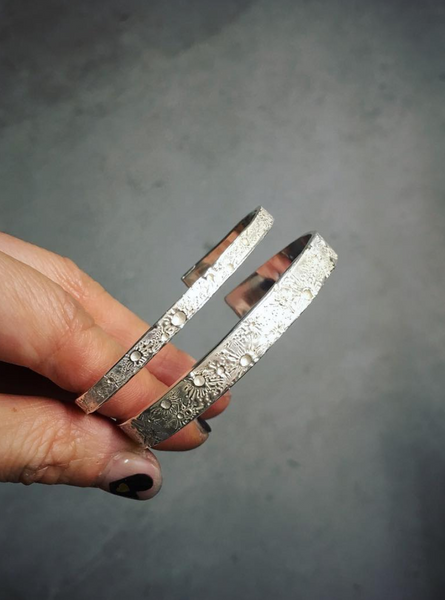 Moon crater bangle silver