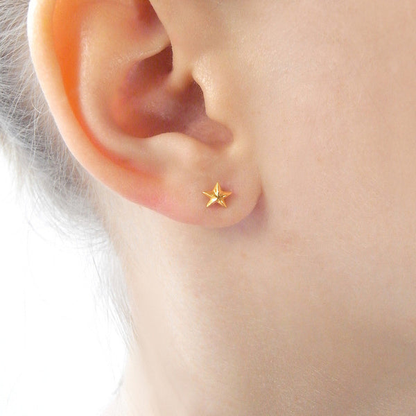 Tiny Star Stud Earrings Gold on Model