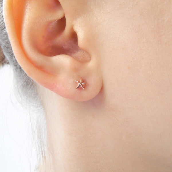 Tiny Star Stud Earrings Rose Gold on Model