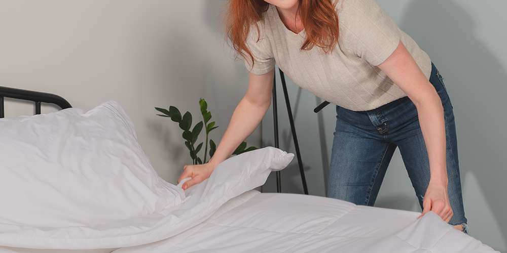 woman-changing-bedding
