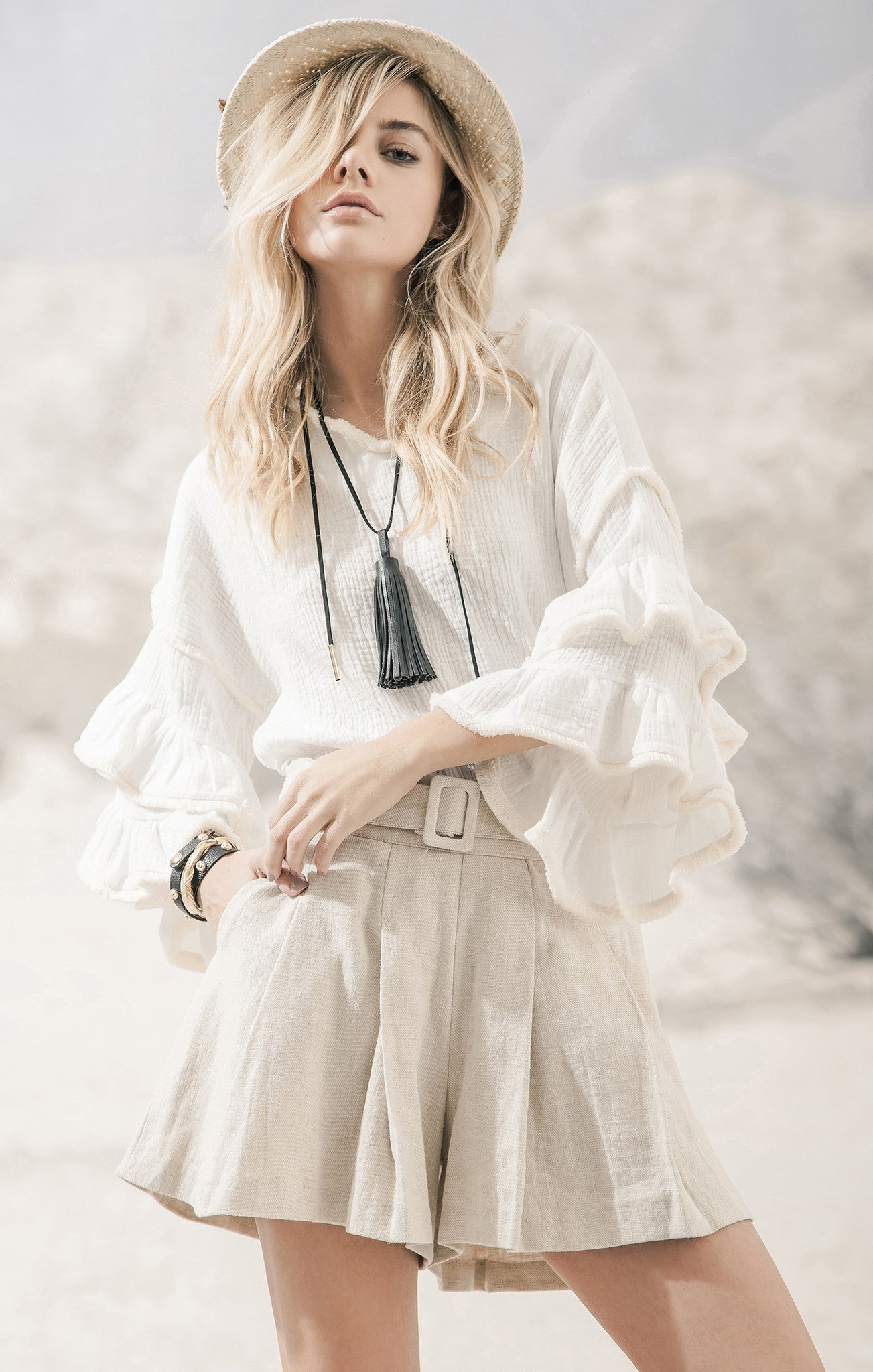 RUFFLE SLEEVES TOP WITH FRINGE DETAIL