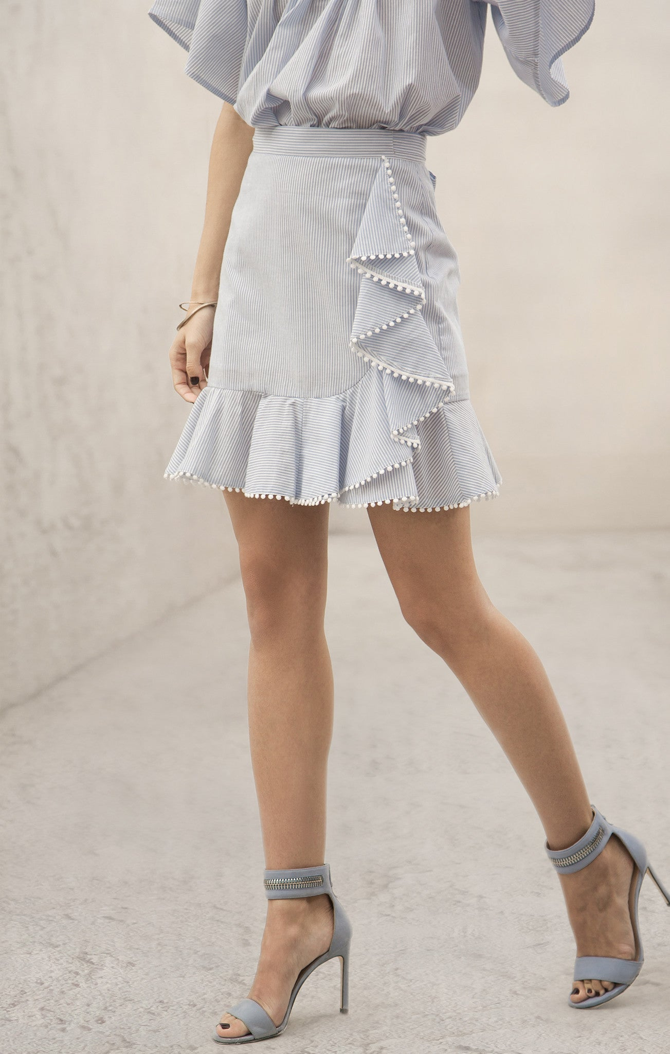 PINSTRIPE SKIRT WITH ASYMMETRICAL RUFFLE