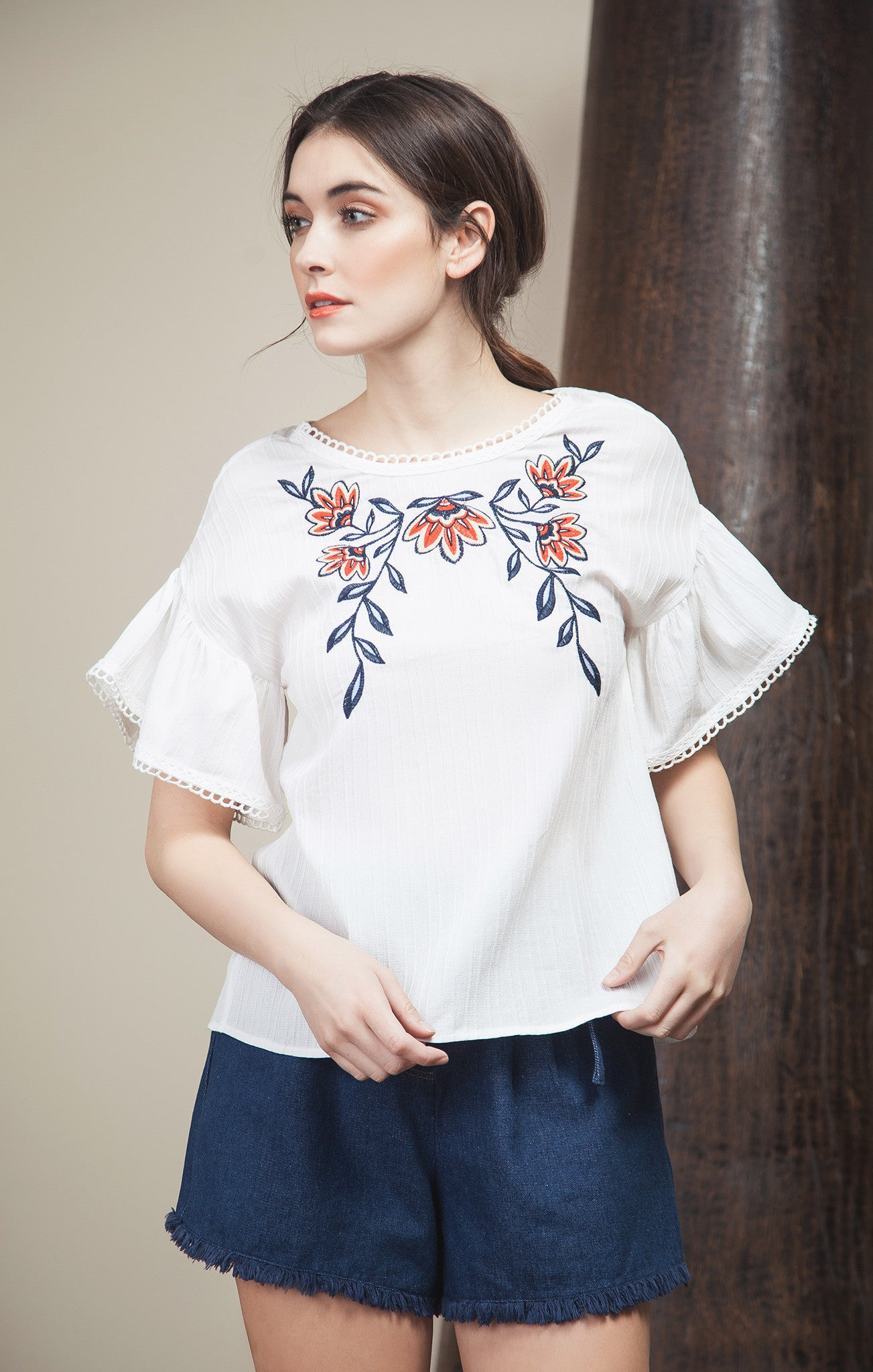 EMBROIDERED TOP WITH TWISTED BACK DETAIL
